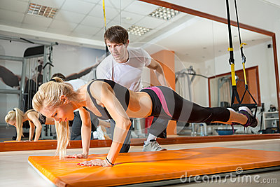 Girl doing pushups with resistance band