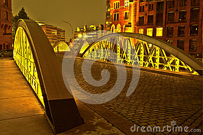 stock image of bridge in the historic speicherstadt (warehouse district) in hamburg