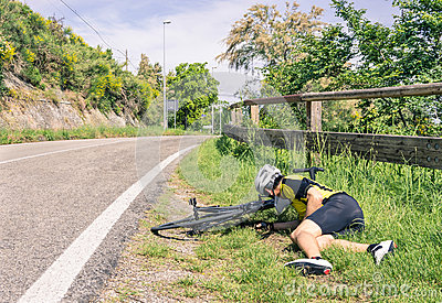 Bicycle accident on the road - Biker in troubles