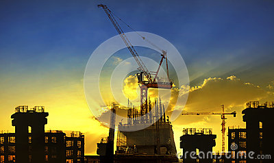 Building and crane construction site against beaut