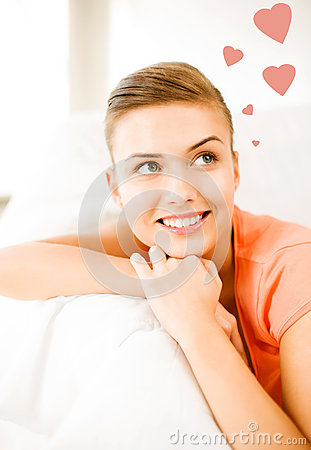 Happy woman in love dreaming at home