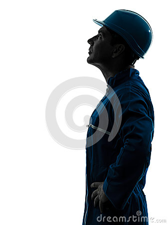 Man construction worker looking up profile silhouette portrait