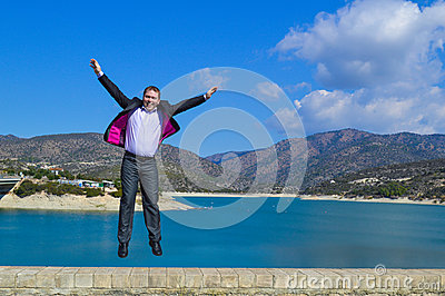 Young man jumping of joy