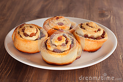Group of delicious swirl buns with raisins and brown sugar