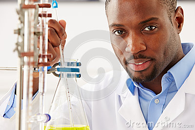 Scientist Studying Liquid In Flask