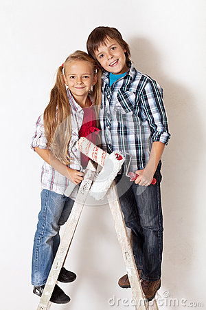 Happy kids ready to paint their room
