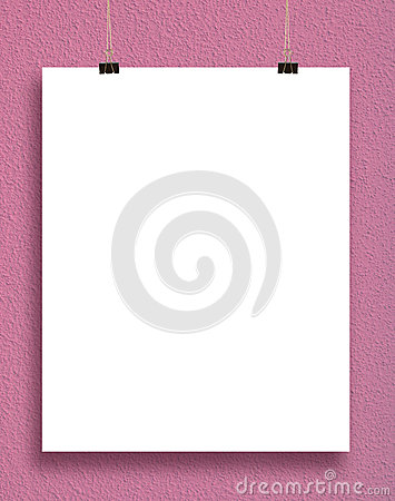 Paper card on a pink wall.