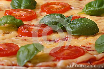 Background margarita pizza with tomato, basil and cheese
