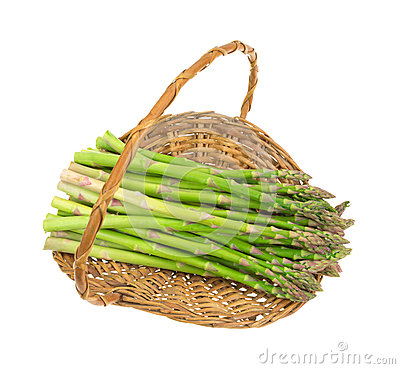 Fresh asparagus stalks in old wicker basket