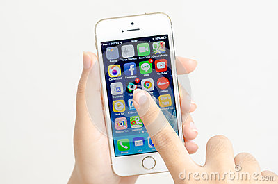 Woman hands holding and touching an Apple iPhone 5s