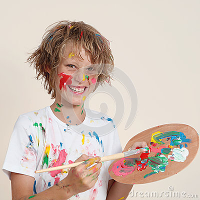 Messy kid with paint pallete