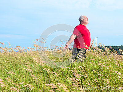 Man in field with breeze