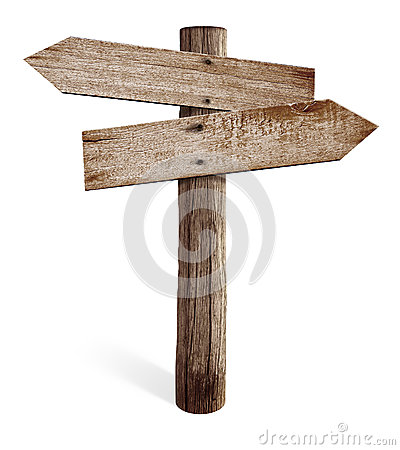 Old wooden road sign with left and right arrows