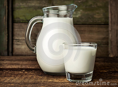 Fresh milk in glass jug and glass