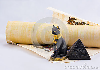 Egyptian cat, a pyramid and papyrus from travels.