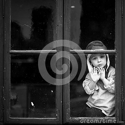 Boy on the window, laughing and drinking tea