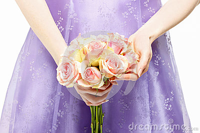 Bridesmaid holding bouquet of pink roses