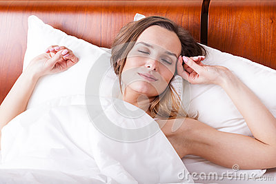 Woman in bed with sweet dreams
