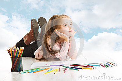 Girl dreaming, looking for drawing idea. Inspiration and creativity