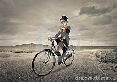 Young woman riding a bike