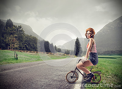 Young woman on a little bike