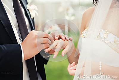 Wedding couple hands close-up during wedding ceremony