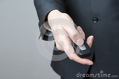 Businessman using car key