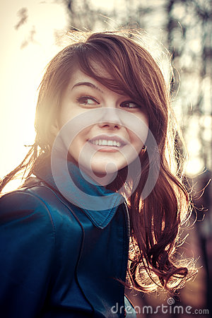 Smile happy young girl outdoor sunlight portrait