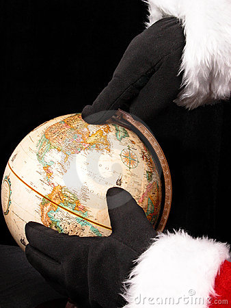 Globe with Santa'a Hands Pointing the Way