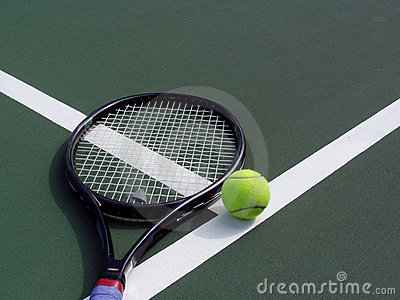 Tennis racquet and Ball on a tennis court