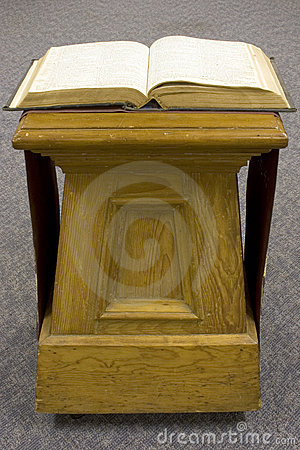 Open Bible on old pine stand.