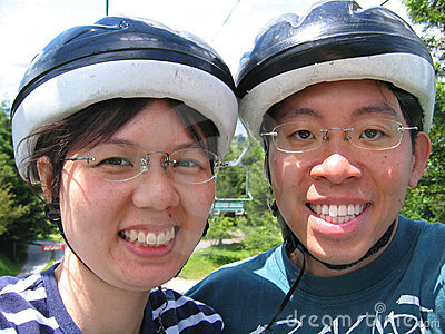 Young couple with helmets