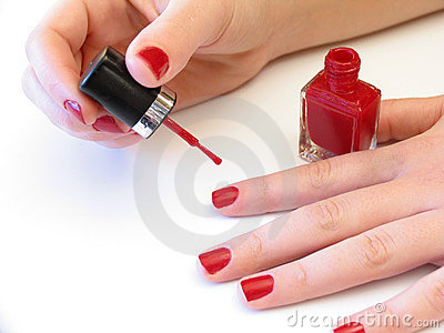 Painting her nails