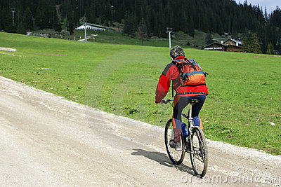 Cyclist on mountain track