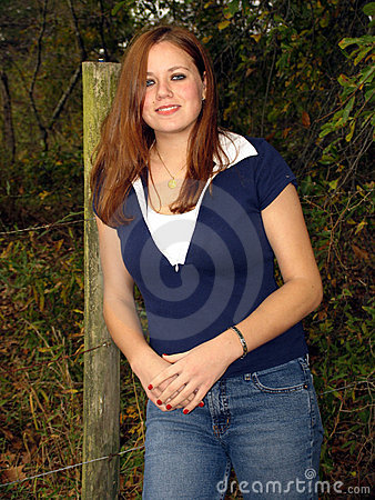 Pretty girl and fence post