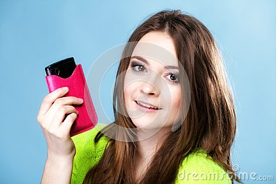Happy girl with mobile phone in pink cover