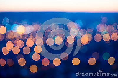 City lights big abstract circular bokeh on blue background