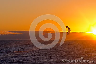 Kite surfer on sunset