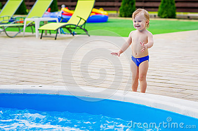 Cute kid by the swimming pool