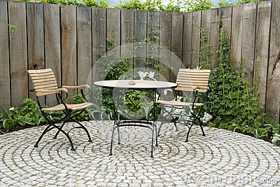 Garden patio with round table and two chairs