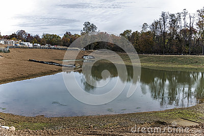 Storm water drainage pond on construction site