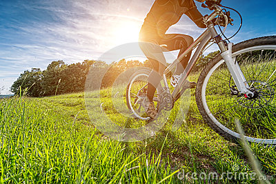 Sport bike, cycling in the beautiful meadow, detail photo