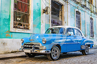 Old classic American blue car parked in the old town of Havana