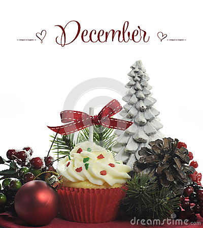 Beautiful Christmas holiday theme cupcake with seasonal flowers and decorations for the month of December