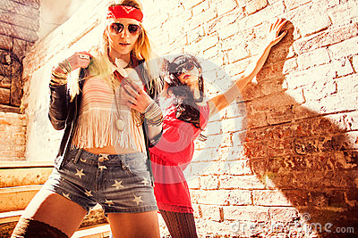 Fashion portrait of a beautiful young womans wearing sunglasses.