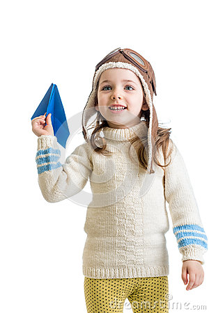 Child girl dressed as pilot playing with paper airplane isol