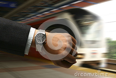 Hand with watch with LRT background
