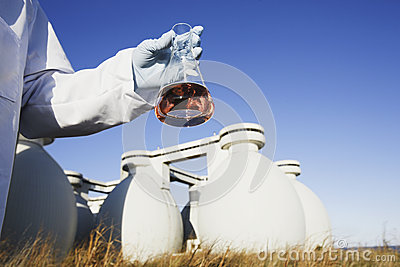 Scientist holding a chemical sample in a flask