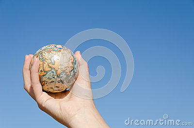 Global earth in hand on blue sky background, Asia