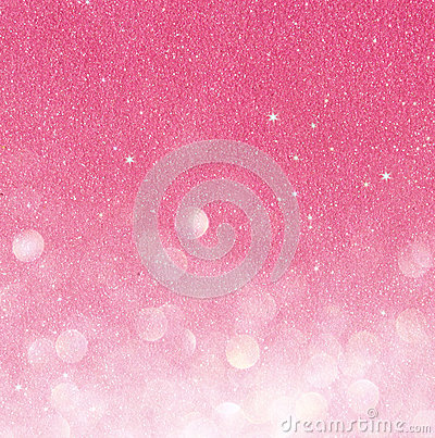 Gold and pink abstract bokeh lights. defocused background.
